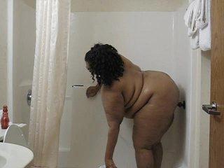 Ebony BBW dildoing in a shower